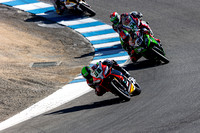 Sep 29, 2013: Tom Sykes #66 on the Kawasaki Racing Team Kawasaki ZX-10R fell into the clutches of Eugene Laverty on #58 and Davide Giugliano at the Corkscrew during World SuperBike race #2